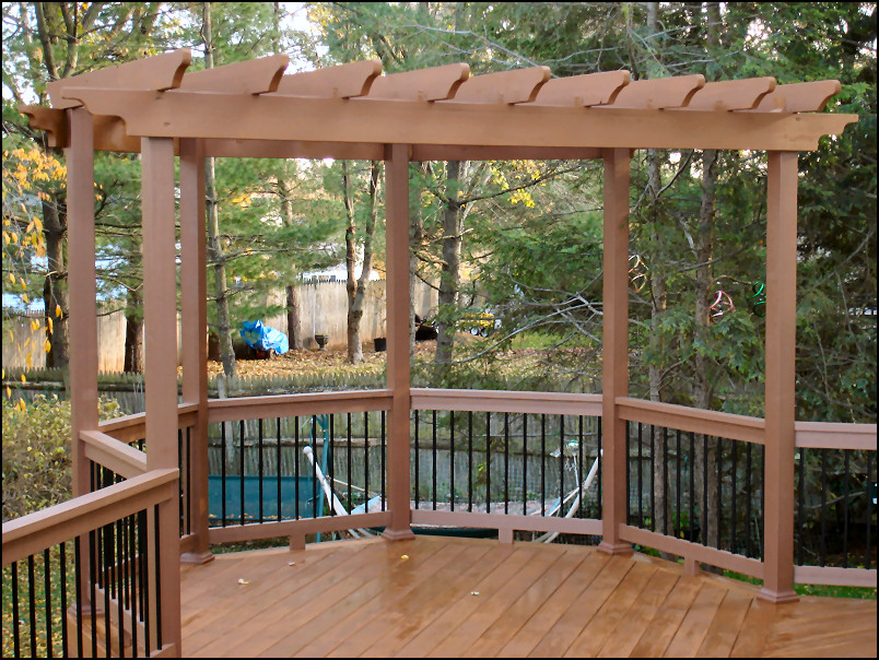 The pergola is built from pressure treated wood. All the pressure treated  wood was stained to match the TimberTech railing. - Hillsborough, NJ - Pressure Treated Deck With TimberTech Builder's