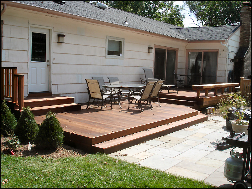 Ground level ipe deck with custom bench deck pros for Building a low profile deck